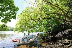 Otentic eco tent experience Mauritius have relaxing moments by the river